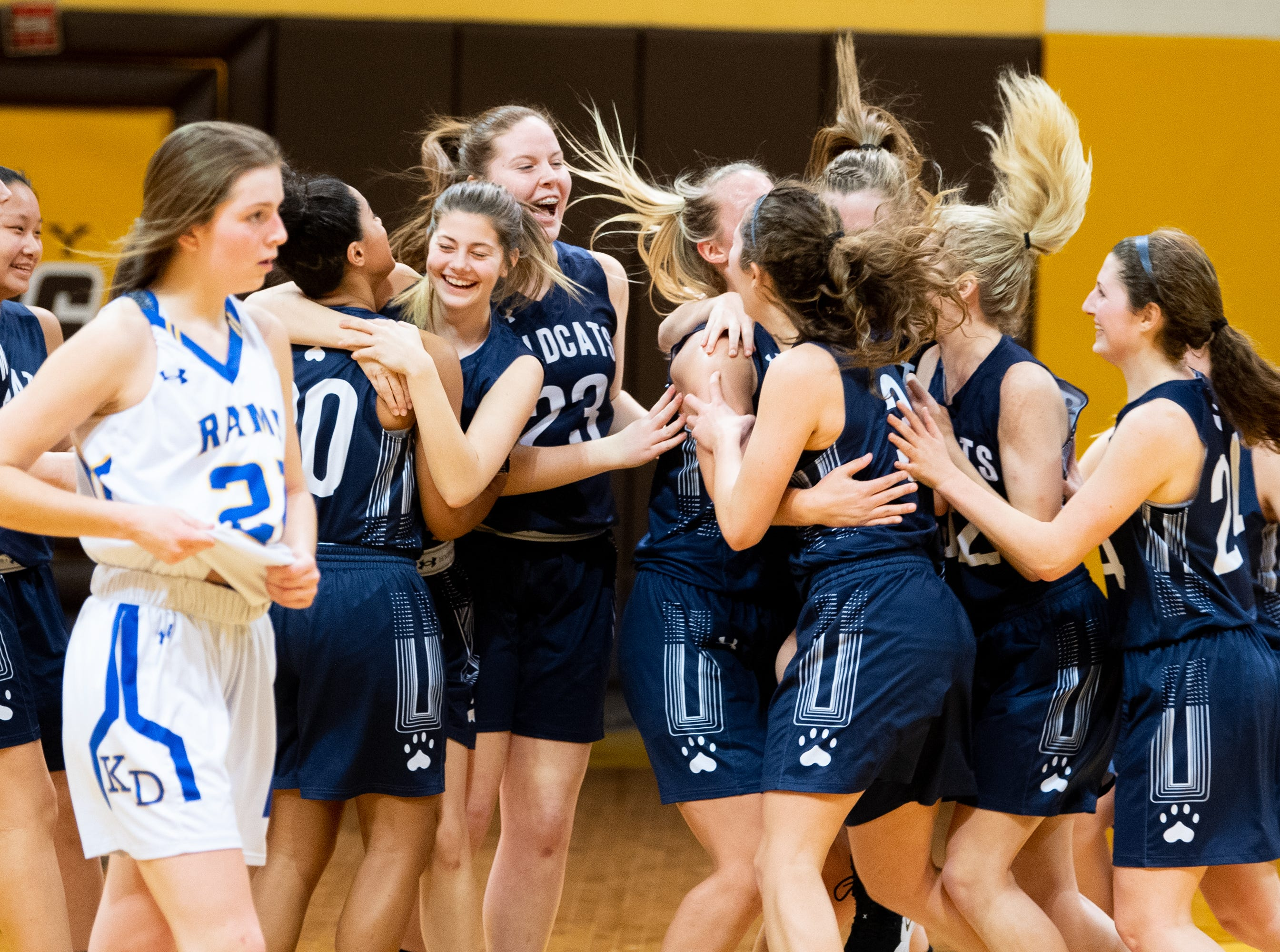 Mifflinburg Area celebrates after defeating Kennard-Dale 51 to 45 in the PIAA second round girls' basketball game, March 13, 2019 at Milton Hershey School. The Rams fell to the Wildcats 51 to 45.
