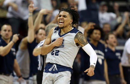Nevada's Jazz Johnson reacts after sinking a three-point basket during the second half of an NCAA college basketball game against Boise State in the Mountain West Conference men's tournament Thursday, March 14, 2019, in Las Vegas. (AP Photo/Isaac Brekken)