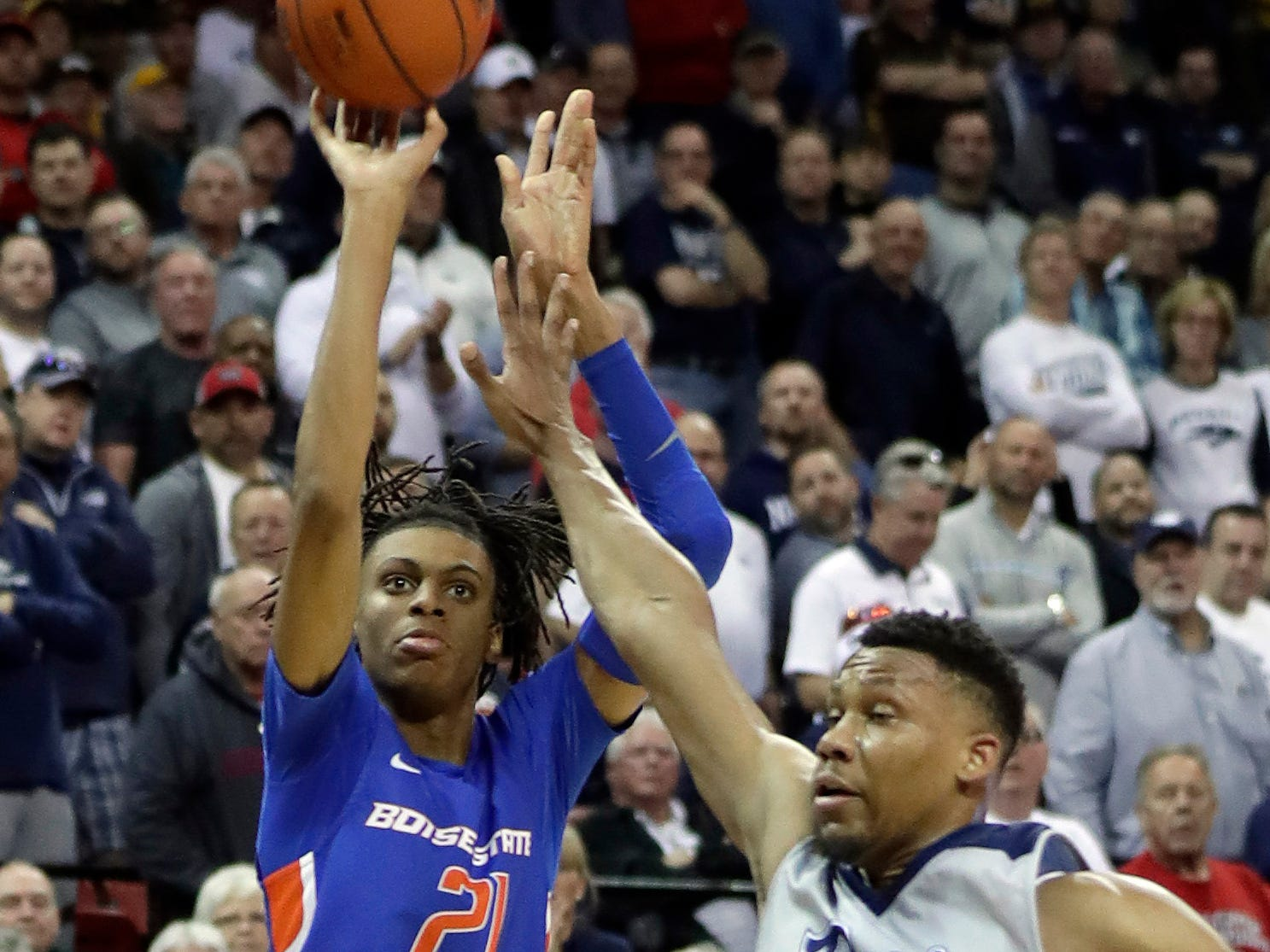 Nevada's Tre'Shawn Thurman (0) covers a shot from Boise State's Derrick Alston during the second half of an NCAA college basketball game in the Mountain West Conference men's tournament Thursday, March 14, 2019, in Las Vegas. (AP Photo/Isaac Brekken)
