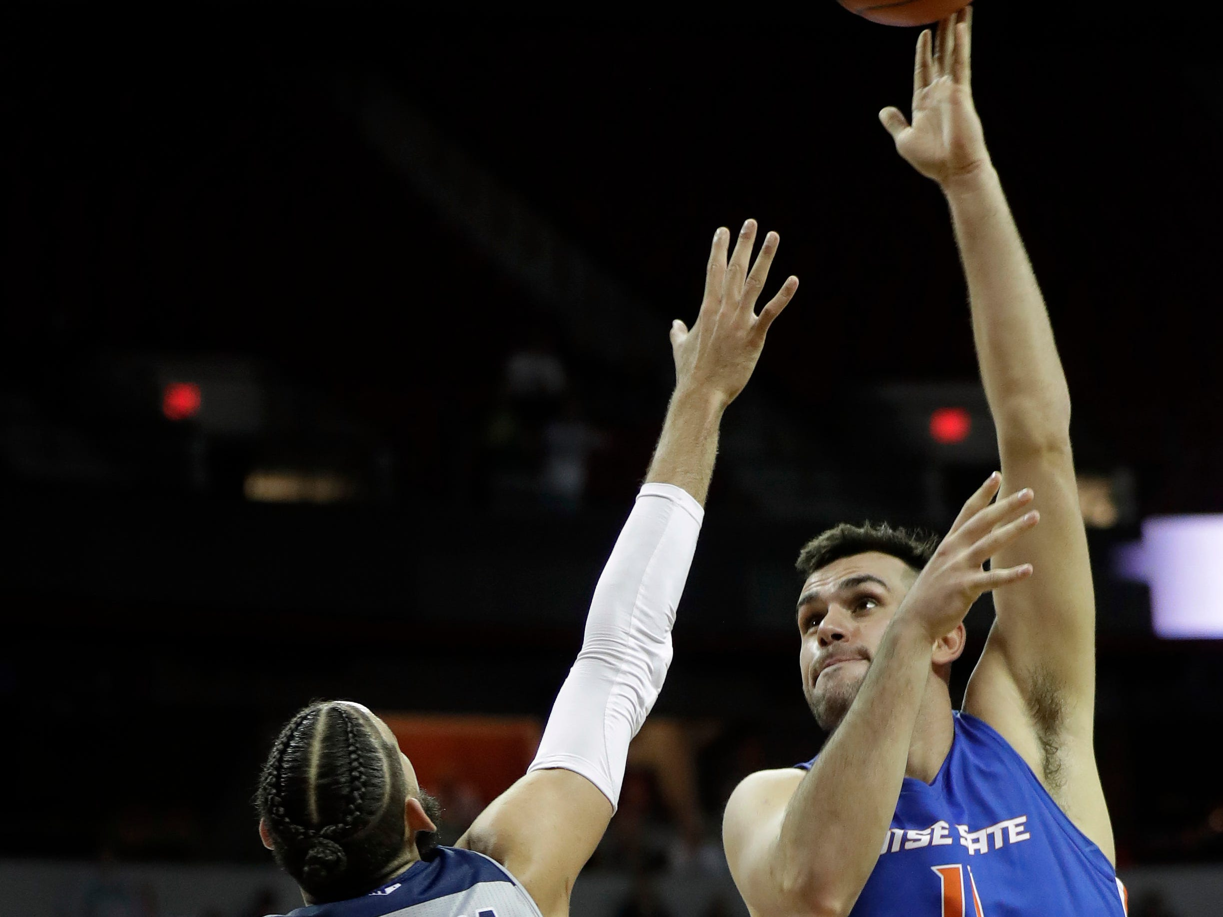 Boise State's Zach Haney, right, shoots as Nevada's Cody Martin defends during the second half of an NCAA college basketball game in the Mountain West Conference men's tournament Thursday, March 14, 2019, in Las Vegas. (AP Photo/Isaac Brekken)
