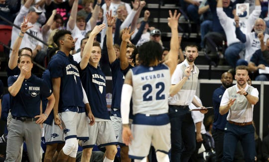The Nevada bench celebrates after Jazz Johnson (22) hits a 3-pointer against Boise State on Thursday in Las Vegas.