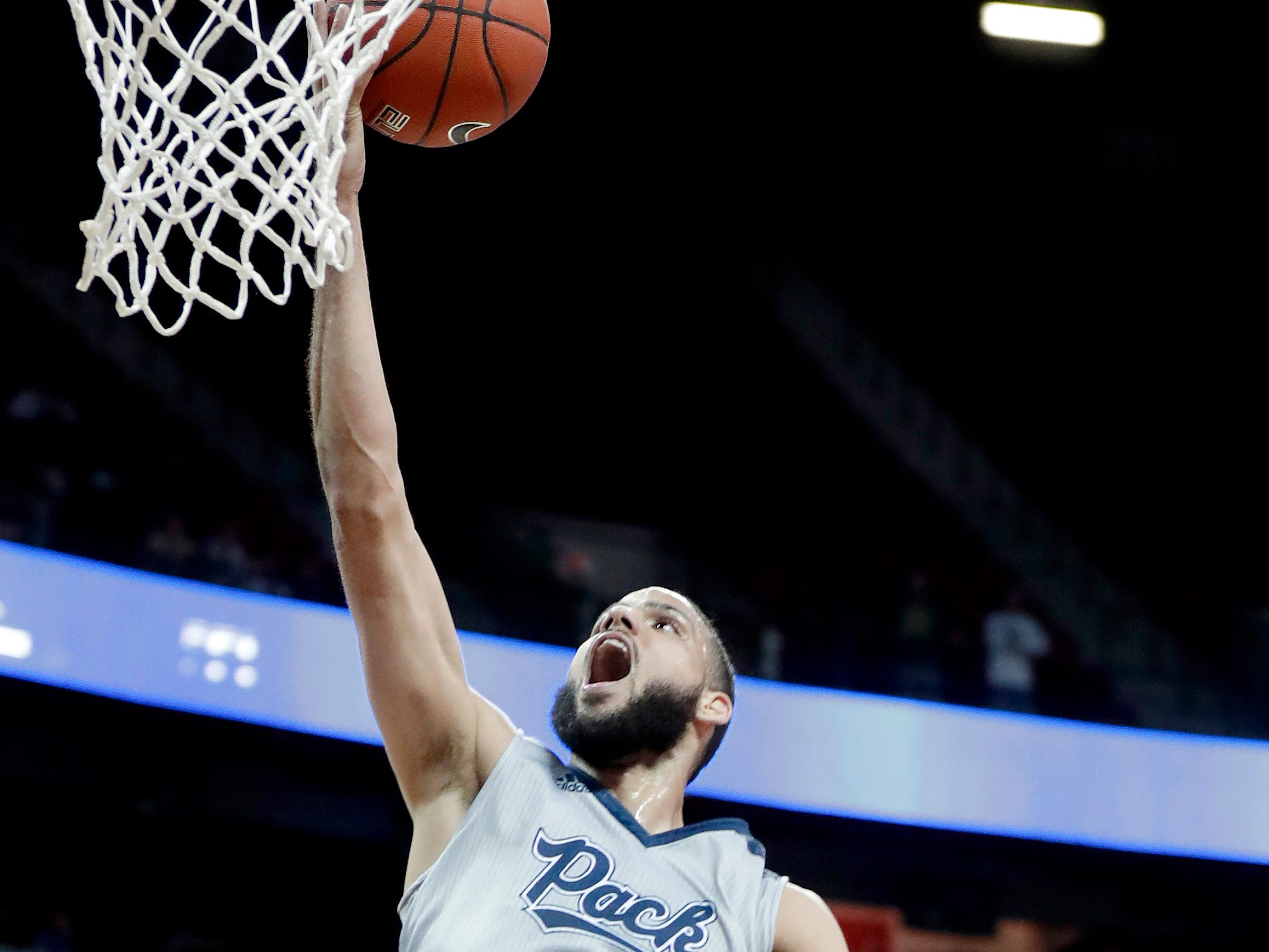 Nevada's Caleb Martin shoots during the first half of an NCAA college basketball game against Boise State in the Mountain West Conference men's tournament Thursday, March 14, 2019, in Las Vegas. (AP Photo/Isaac Brekken)