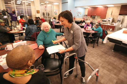 Lifespan's Julie Battaglia visits with seniors during a luncheon at the Maplewood YMCA.