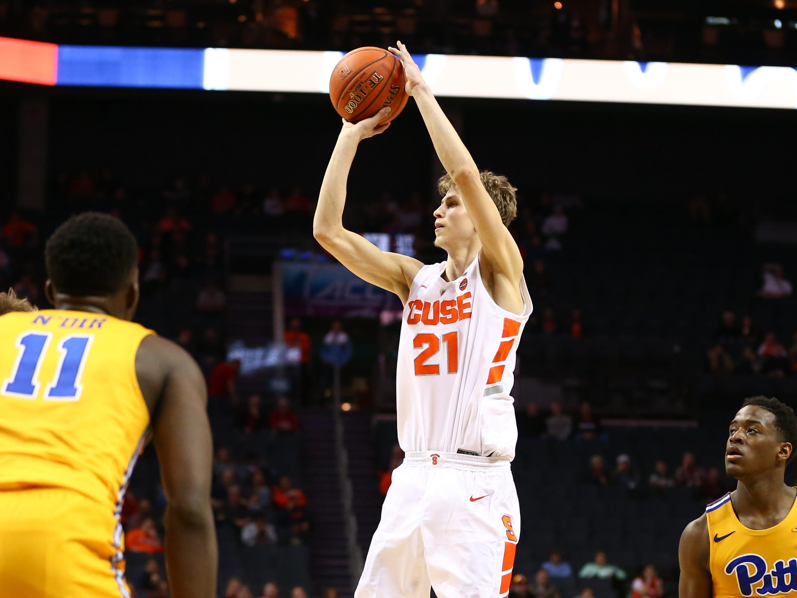 Syracuse forward Marek Dolezaj (21) shoots the ball against Pittsburgh.