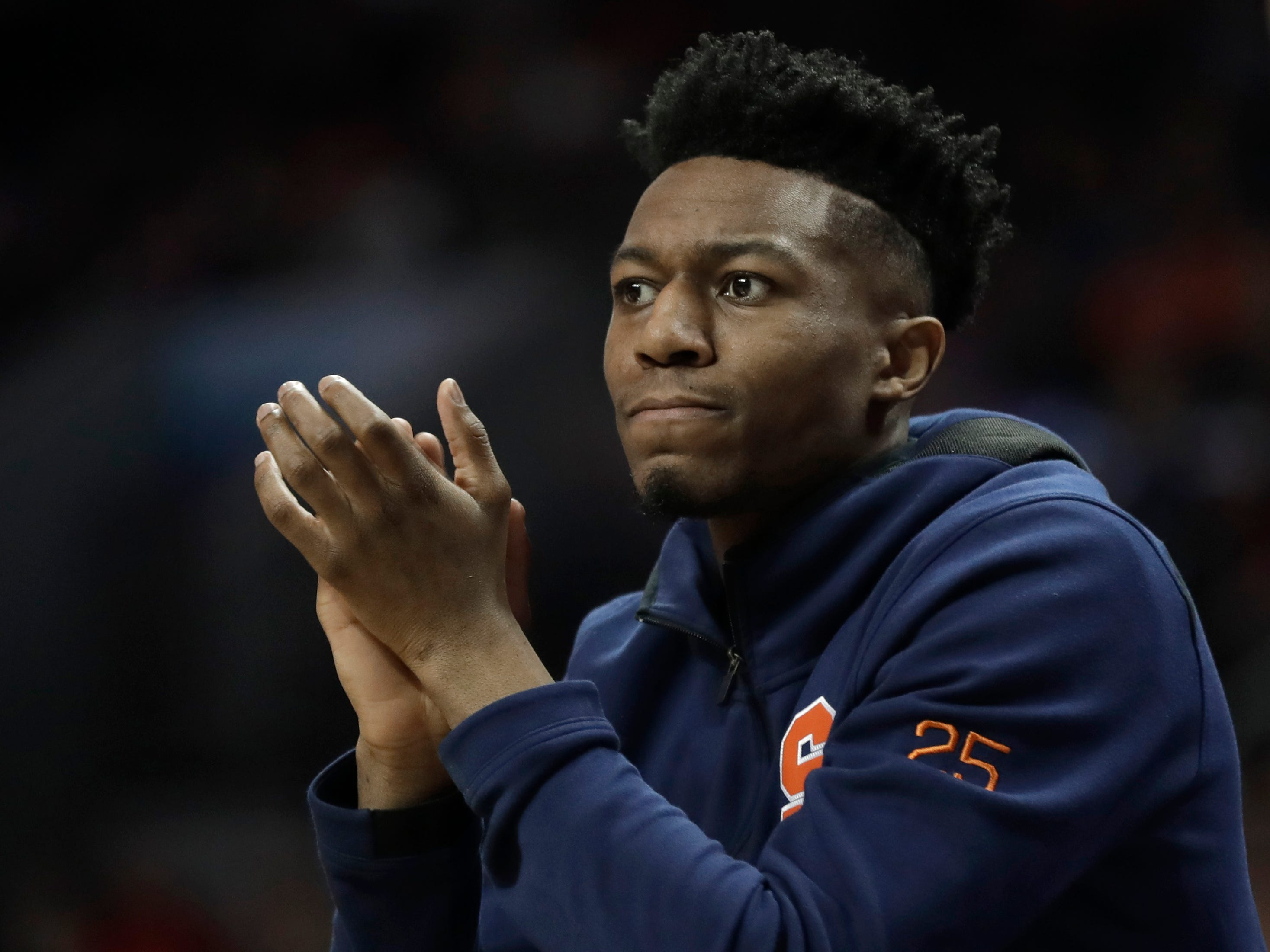 Syracuse's Tyus Battle cheers his teammates from the bench during the first half of an NCAA college basketball game against Pittsburgh in the Atlantic Coast Conference tournament in Charlotte, N.C., Wednesday, March 13, 2019. Battle was unable to play due to an injury.