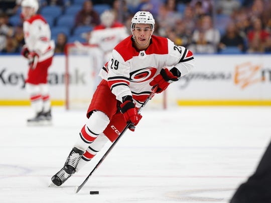 Williamsville native Andrew Poturalski (29) skates with the puck for the Carolina Hurricanes during an exhibition game against the Buffalo Sabres in 2017. Poturalksi is one of the top players for the Charlotte Checkers.