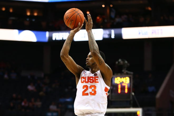 Syracuse Orange guard Frank Howard (23) shoots the ball against the Pittsburgh Panthers in the second half in the ACC conference tournament at Spectrum Center.