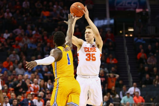 Syracuse Buddy Boeheim (35) shoots the ball against Pittsburgh Panthers guard Xavier Johnson (1) in the second half of the Orange's 73-59 win over Pittsburgh in the ACC Tournament on Wednesday night. Boeheim scored a career-high 20 points.