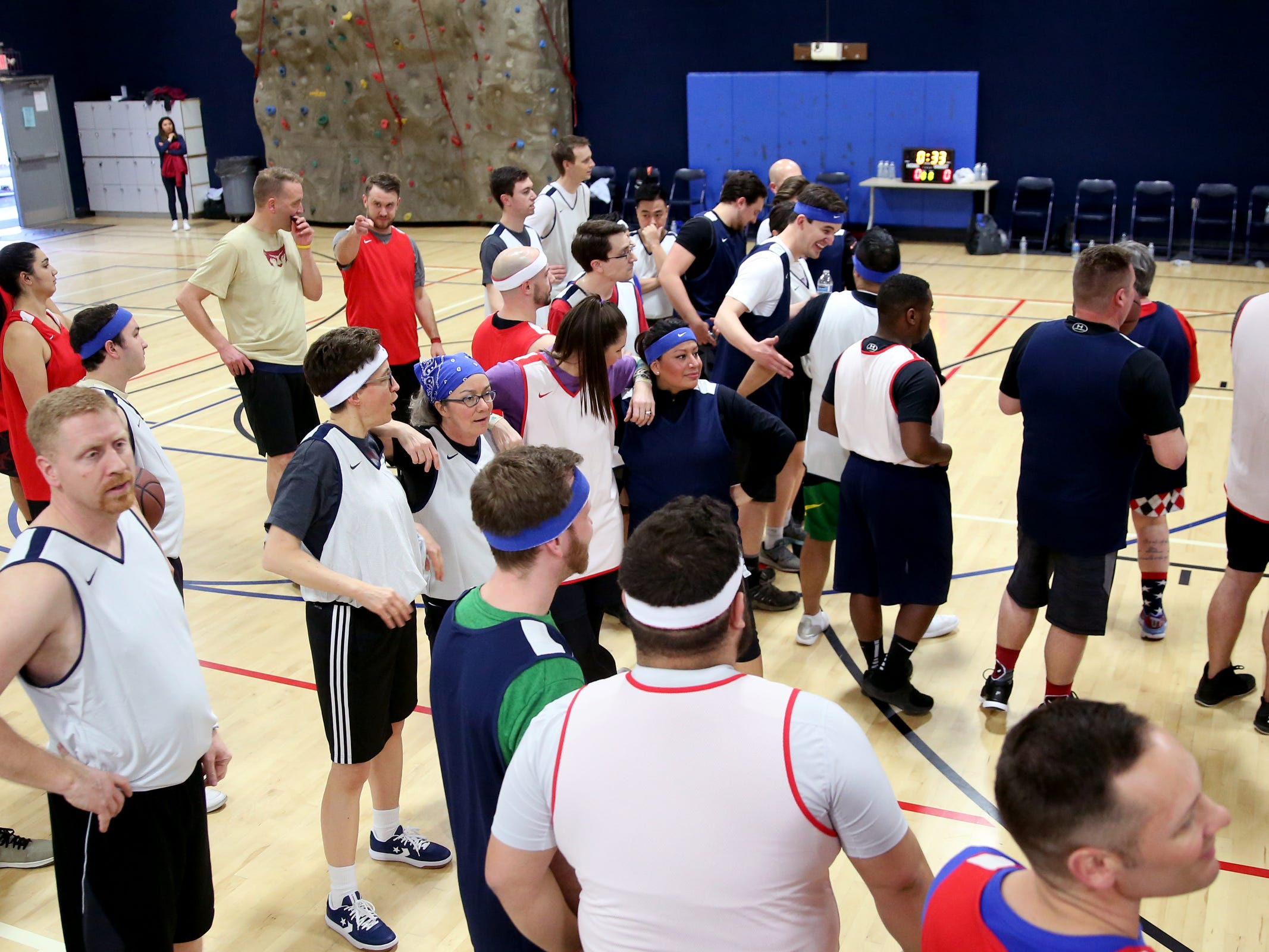 Players gather before the start of the second annual House vs. Senate charity basketball tournament at the Boys & Girls Club in Salem on March 13, 2019. The tournament raised more than $10,000 for the Oregon Alliance of Boys & Girls Clubs.