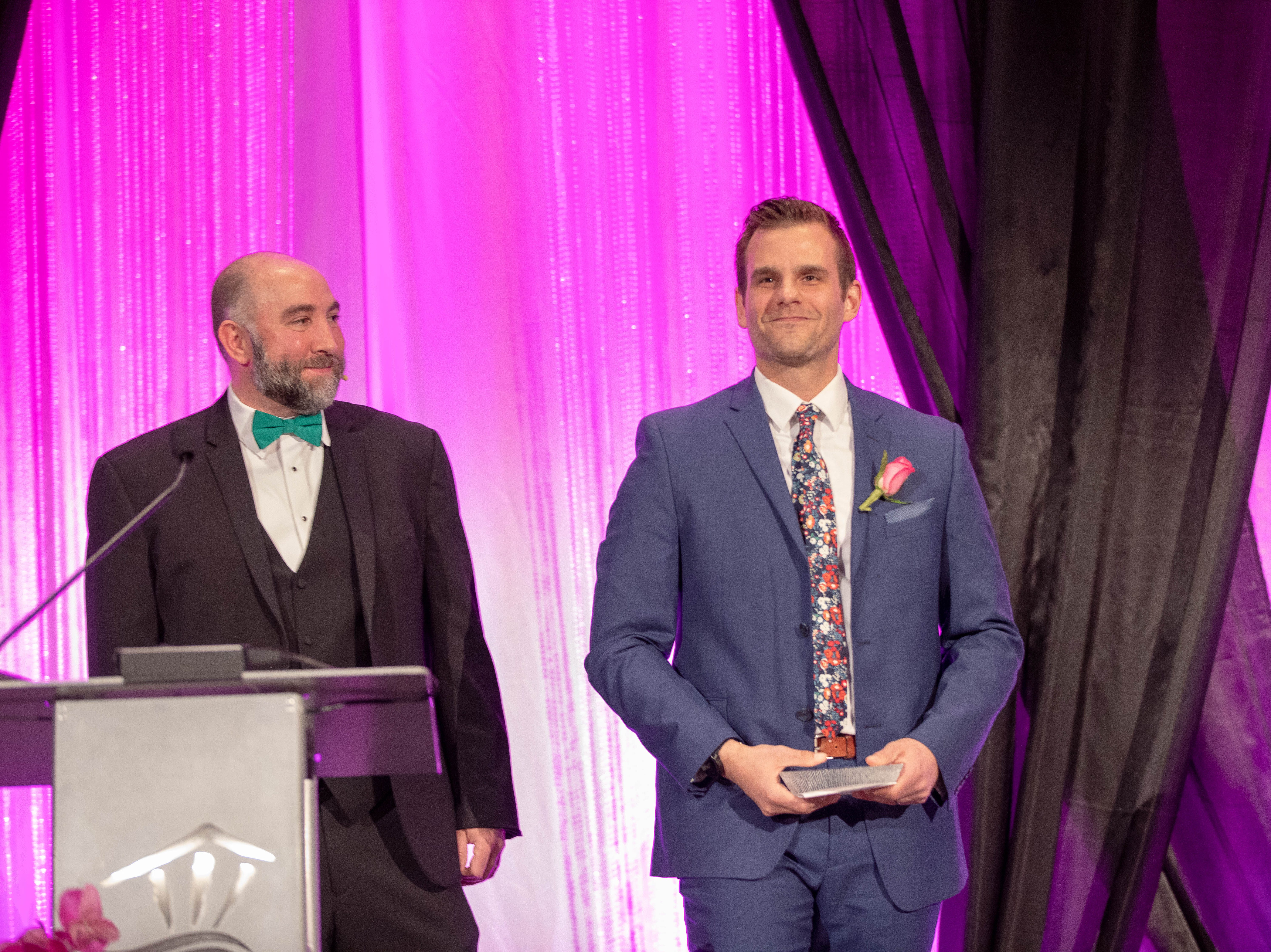 Host TJ Sullivan, Owner of Huggins Insurance, and Alvin Klausen, of Vagabond Brewing, winner of the Outstanding Young Professional award at the First Citizen Awards Banquet March 8, 2019, at the Salem Convention Center.