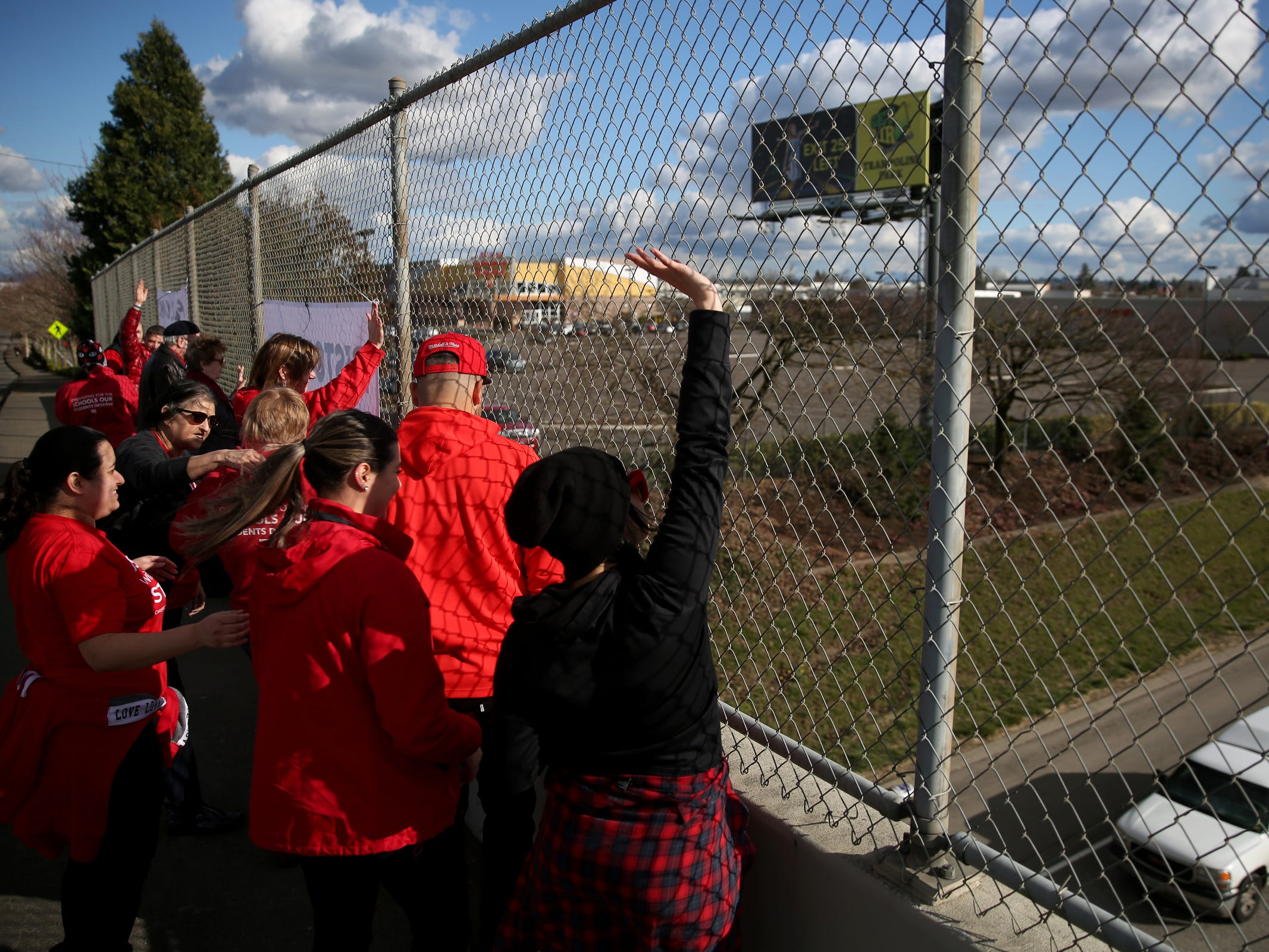 Dozens of educators and supporters rally in support of statewide education budget increases on the D and Center Streets I-5 overpasses in Salem on March 13, 2019.