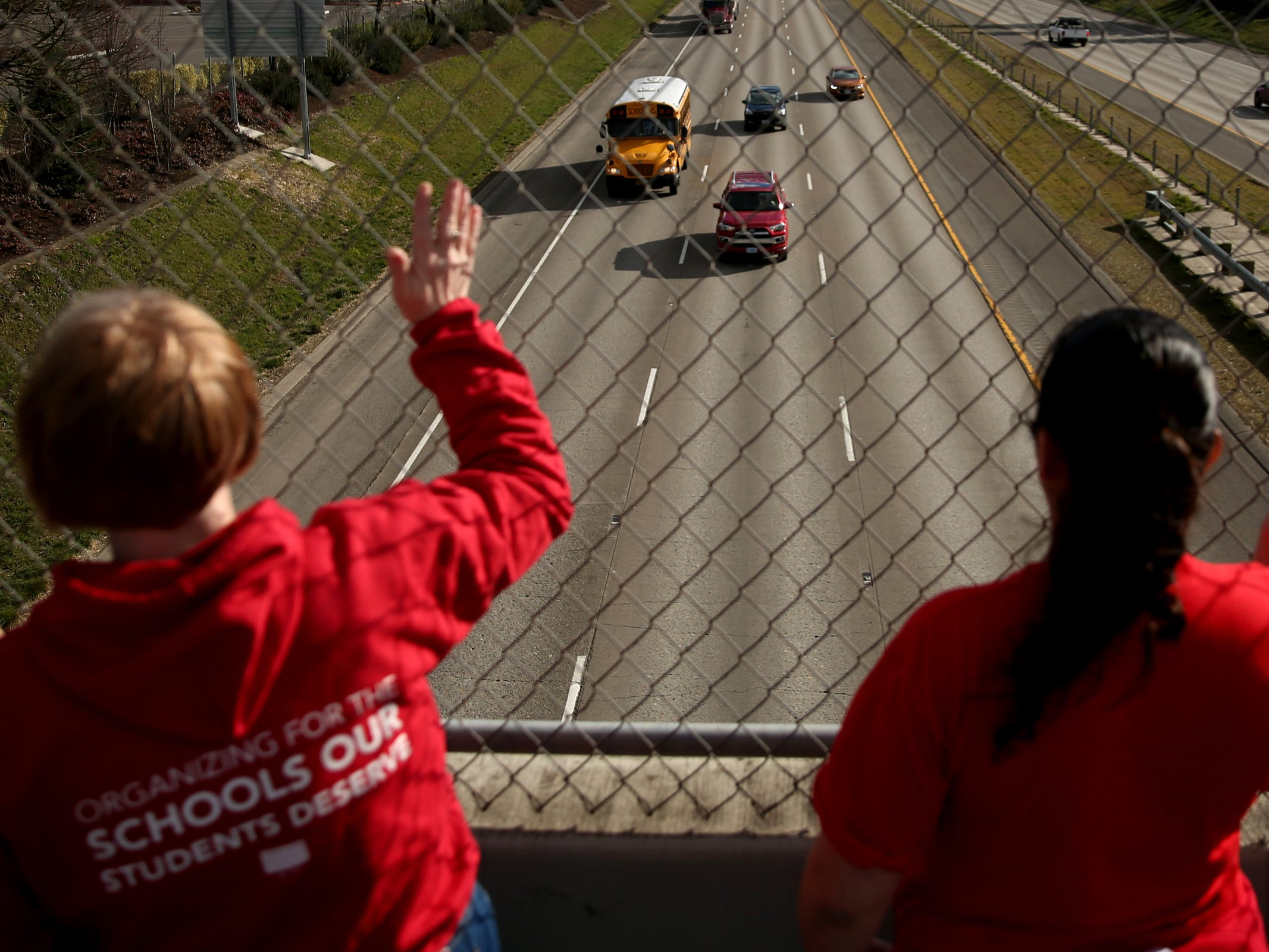 "Dozens of educators and supporters rally in support of statewide education budget increases on the D and Center Streets I-5 overpasses in Salem on March 13, 2019. ""We need more counselors Ð we need social workers,"" Mindy Merritt, the president of the Salem Keizer Education Association, said. ""That's not going to happen without appropriate funding."""