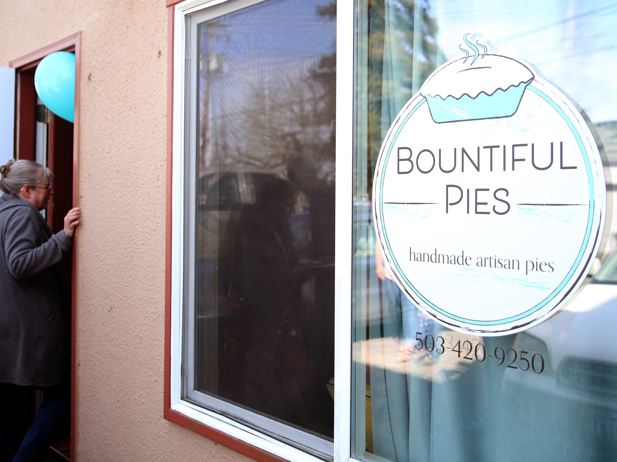 People line-up for free samples during a Pi Day celebration and shop opening at Bountiful Pies in West Salem on March 14, 2019.