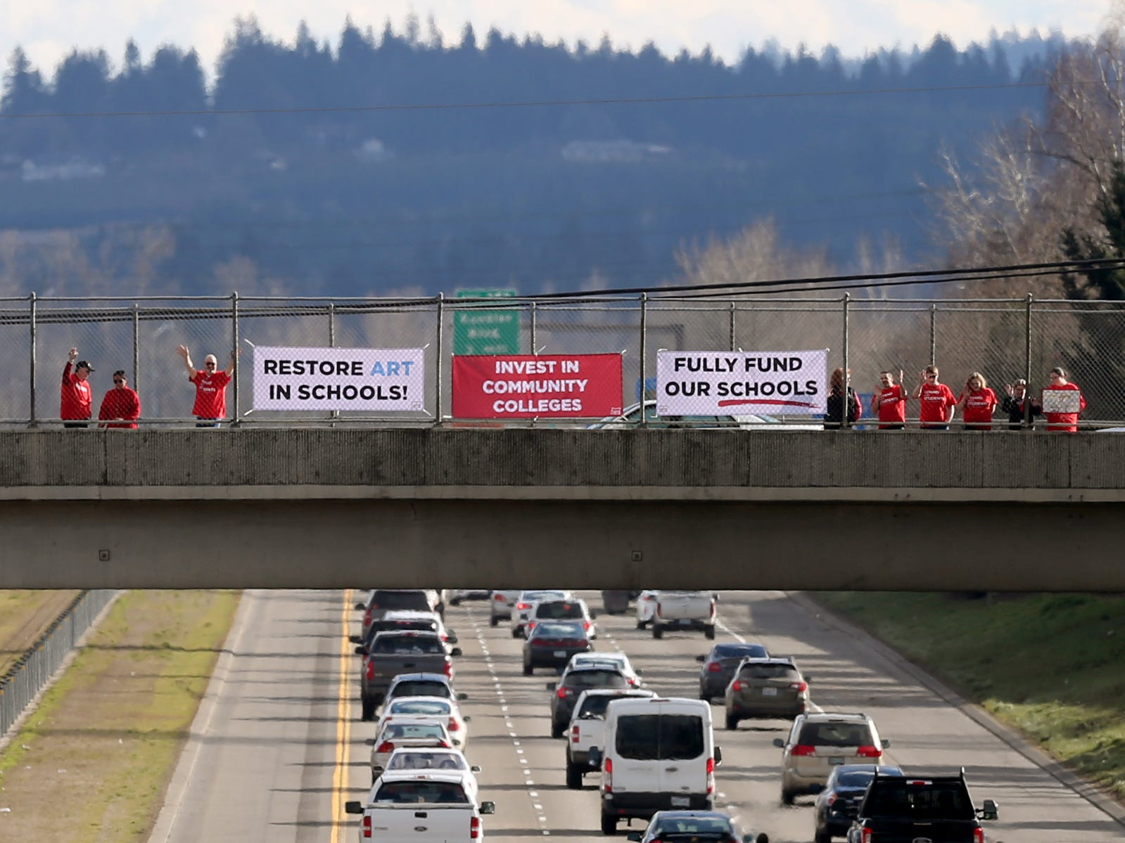 "Dozens of educators and supporters rally in support of statewide education budget increases on the D and Center Streets I-5 overpasses in Salem on March 13, 2019. ""Class size matters,"" said Mindy Merritt, the president of the Salem Keizer Education Association. She said there are kindergarten classrooms in Salem-Keizer that have more than 30 students with one teacher."