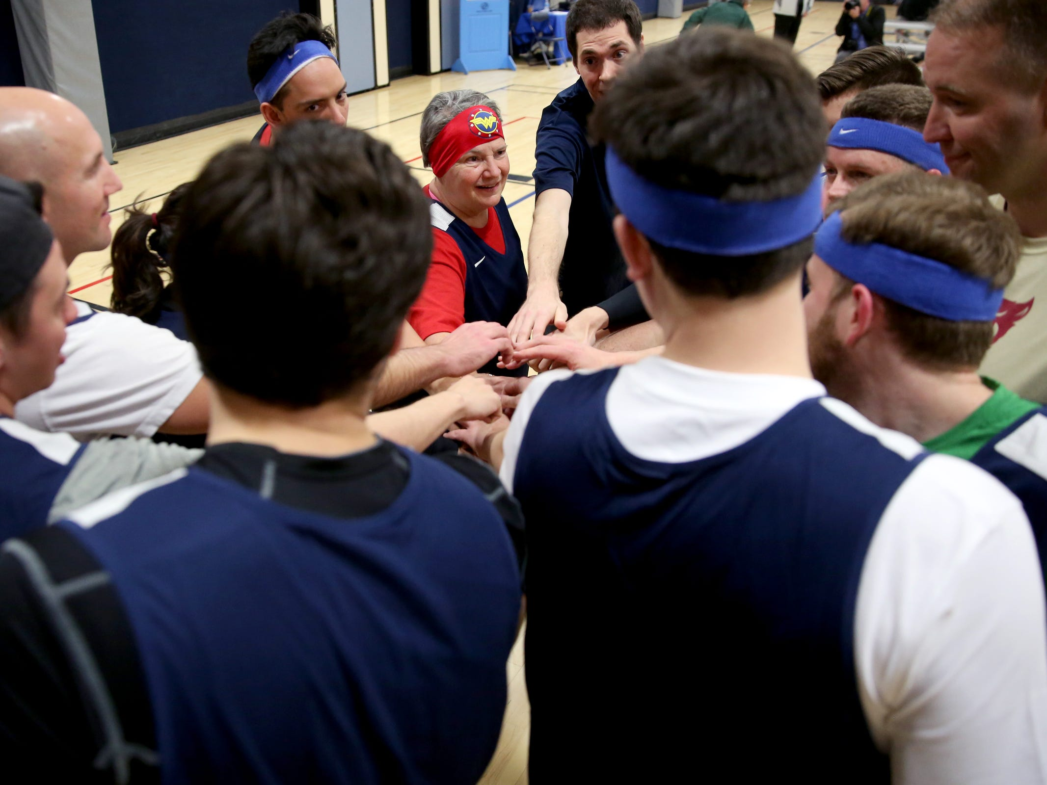 A House team, with Rep. Carla Piluso, huddles together before the start of the second annual House vs. Senate charity basketball tournament at the Boys & Girls Club in Salem on March 13, 2019. The tournament raised more than $10,000 for the Oregon Alliance of Boys & Girls Clubs.