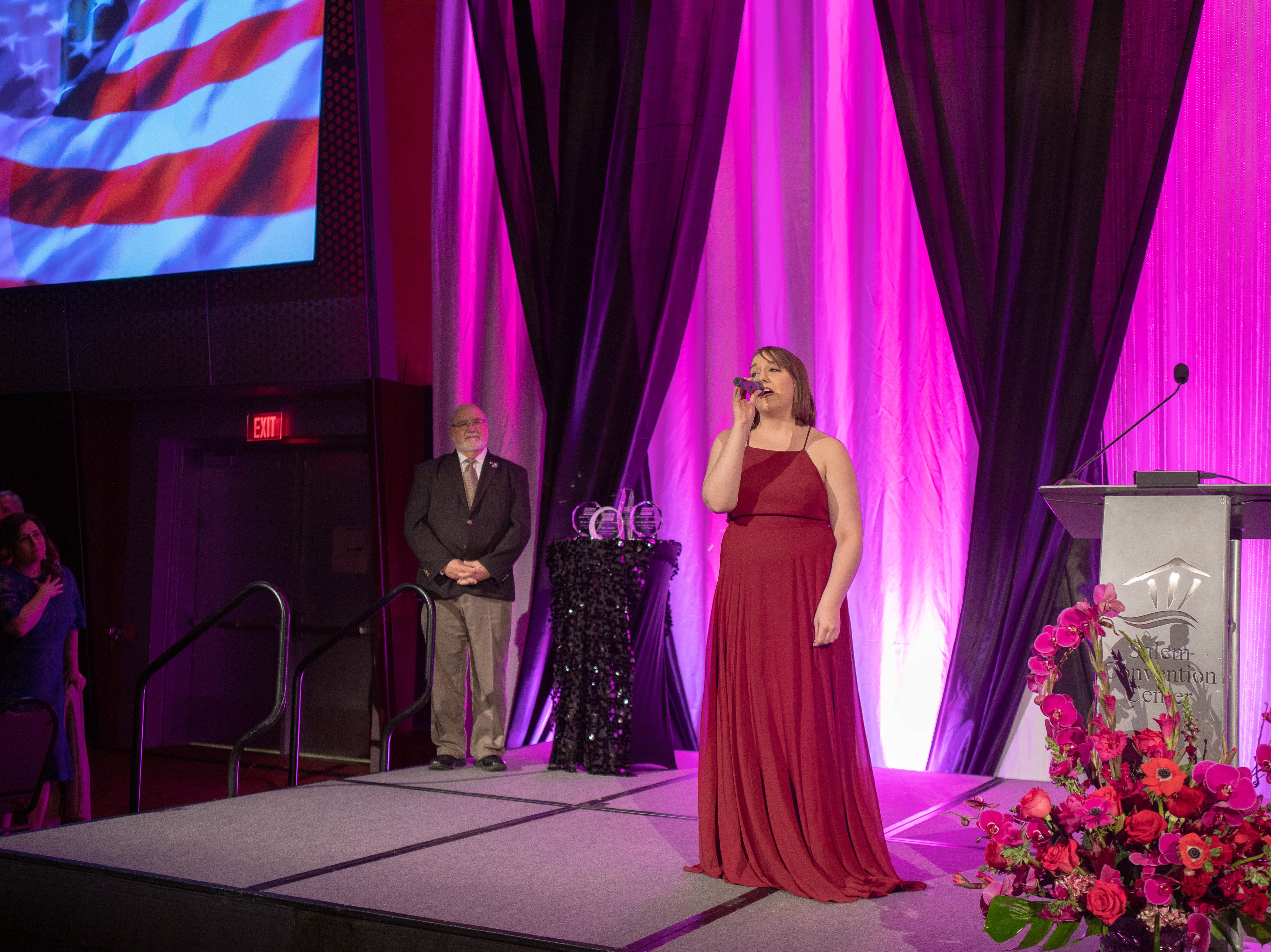 Ariana Pippert singing the National Anthem at the First Citizen Awards Banquet March 8, 2019, at the Salem Convention Center.