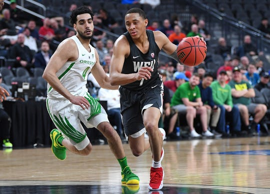 Washington State Cougars guard Jervae Robinson (1) dribbles inside Oregon Ducks guard Ehab Amin (4) during the second half of a Pac-12 conference tournament game at T-Mobile Arena.