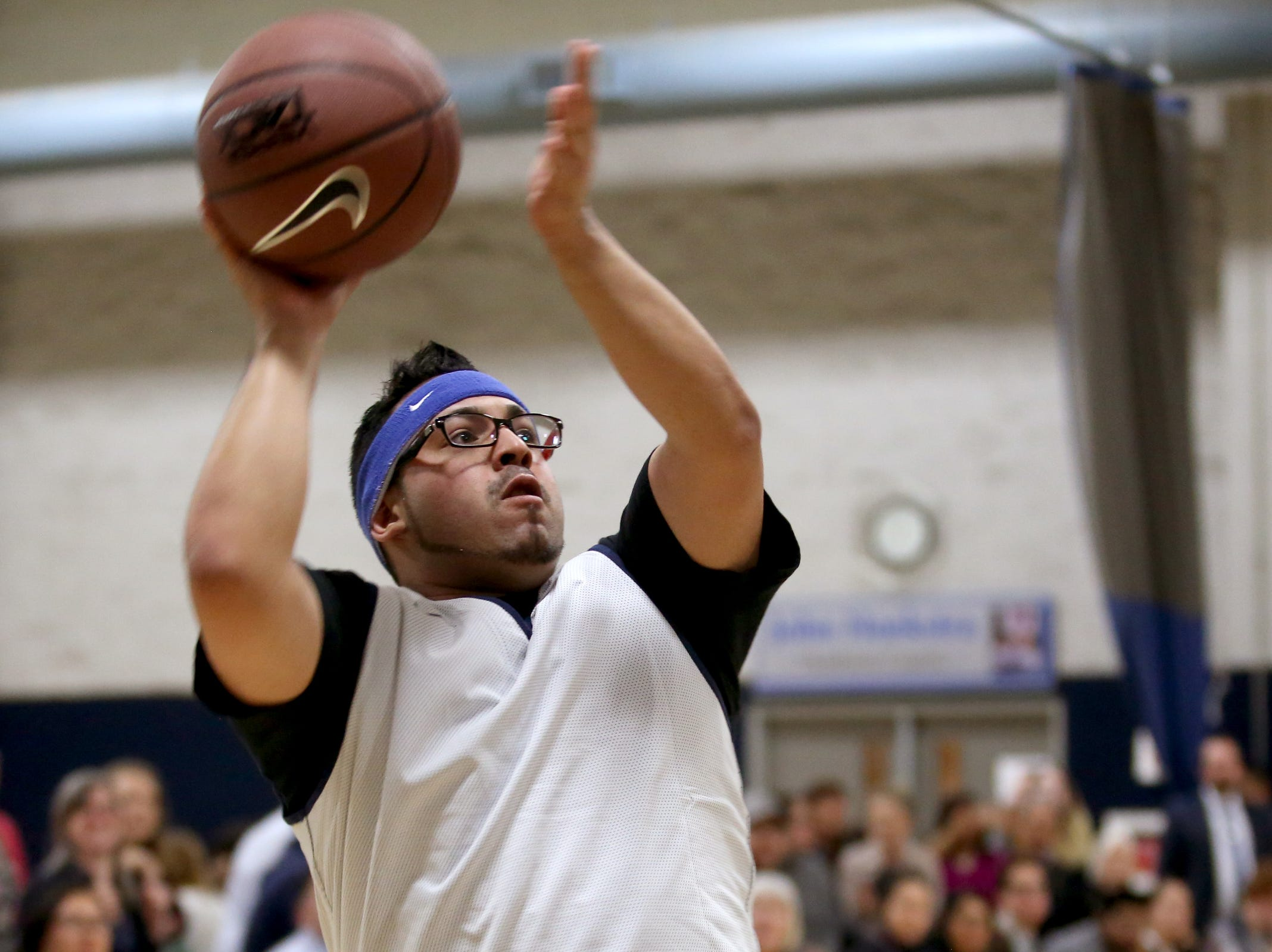 Rep. Diego Hernandez takes a shot in the second annual House vs. Senate charity basketball tournament at the Boys & Girls Club in Salem on March 13, 2019. The tournament raised more than $10,000 for the Oregon Alliance of Boys & Girls Clubs.