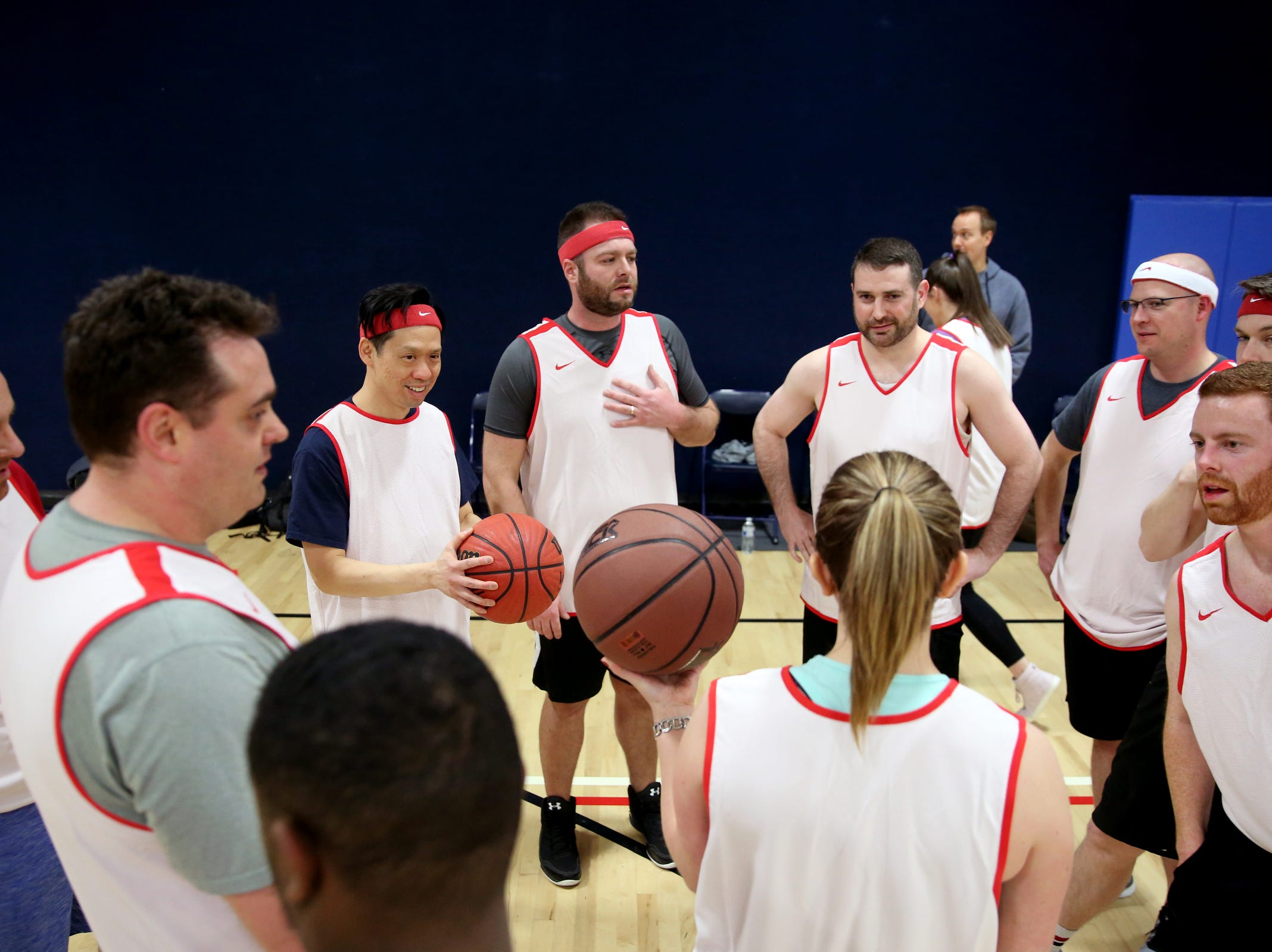 A Senate team huddles together before the start of the second annual House vs. Senate charity basketball tournament at the Boys & Girls Club in Salem on March 13, 2019. The tournament raised more than $10,000 for the Oregon Alliance of Boys & Girls Clubs.