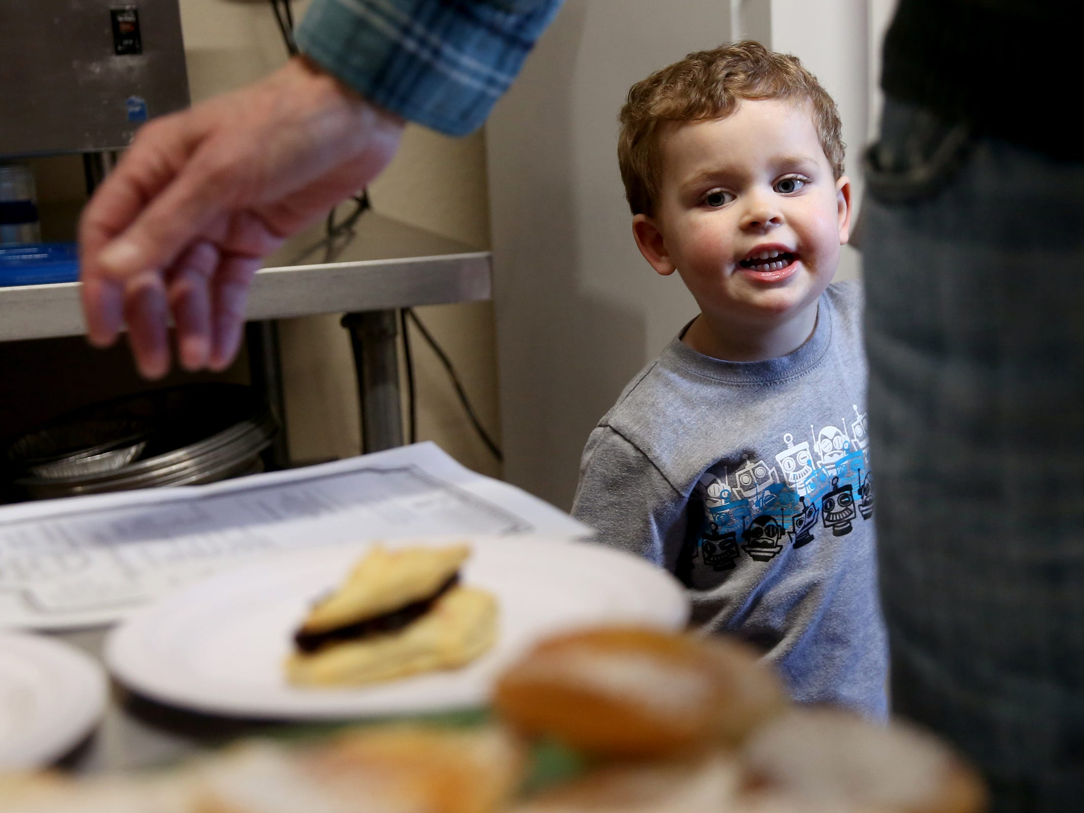 Isaac Cotton, 3, of West Salem, eyes some pie samples during a Pi Day celebration and shop opening at Bountiful Pies in West Salem on March 14, 2019.