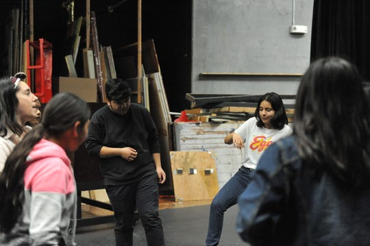 "Alongside Emily Morales, assistant director of ""ReAlisal: Students from East Salinas,"" students prepare to rehearse for the play, which will show this weekend at Alisal High School."
