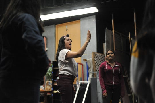 "Emily Morales, founder and artistic director of Artists Ink, helps actors prepare to rehearse ""ReAlisal: Stories from East Alisal"" Wednesday night."