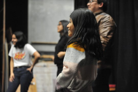 "Alejandra Ayala, an actor in ""ReAlisal: Stories from East Salinas,"" smiles during rehearsal Wednesday night."