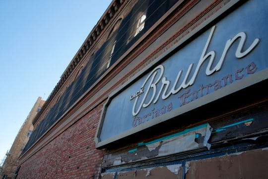 The owner of the Dick Bruhn, which a fire gutted in 2016, says he's open to selling the property but also is trying to renovate it as a mixed-use building.