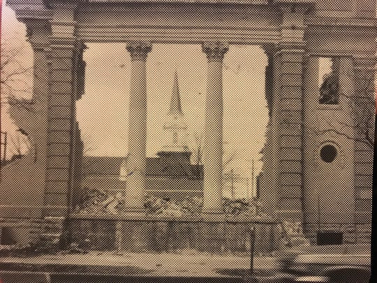 The steeple of the new First Christian Church, 29 N. Oakes St, is visible through the partially-demolished wall of the old building, which changed the landscape of downtown San Angelo in 1955.