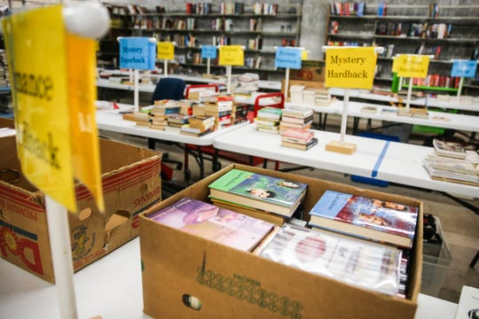 Volunteers sort books into 50 categories in preparation for the Friends of the Library Annual Book Sale. The sale is set for March 22-25 at the McNease Convention Center.