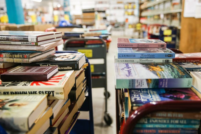 Volunteers sort through books in preparation for the Friends of the Library Annual Book Sale Tuesday, March 12, 2019, at Stephens Central Library. The sale is set for March 22-25.