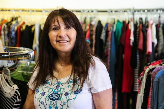 Marie Aguirre preps the shop for the day Thursday, March 14, 2019, at A Second Look Consignment.