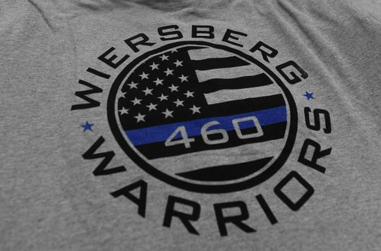 The Fruitland Police Department has gathered together to raise money to help fellow Officer Spencer Wiersberg's battle against cancer. They are selling t-shirts to help with his family's needs and medical expenses. Thursday, March 14, 2019.