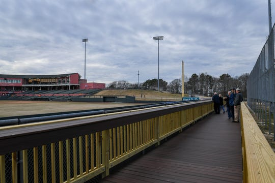 People admire the view of Perdue Stadium from the new wrap around boardwalk deck at an open house event on Wednesday, Mach 13, 2019.