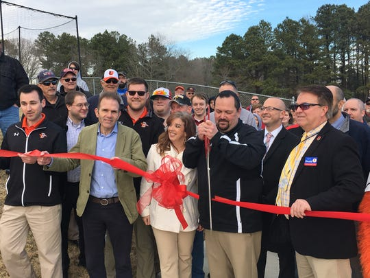 Delmarva Shorebirds general manager Chris Bitters cuts the ribbon to open the 360-degree concourse deck at Perdue Stadium on Wednesday, March 13, 2019.