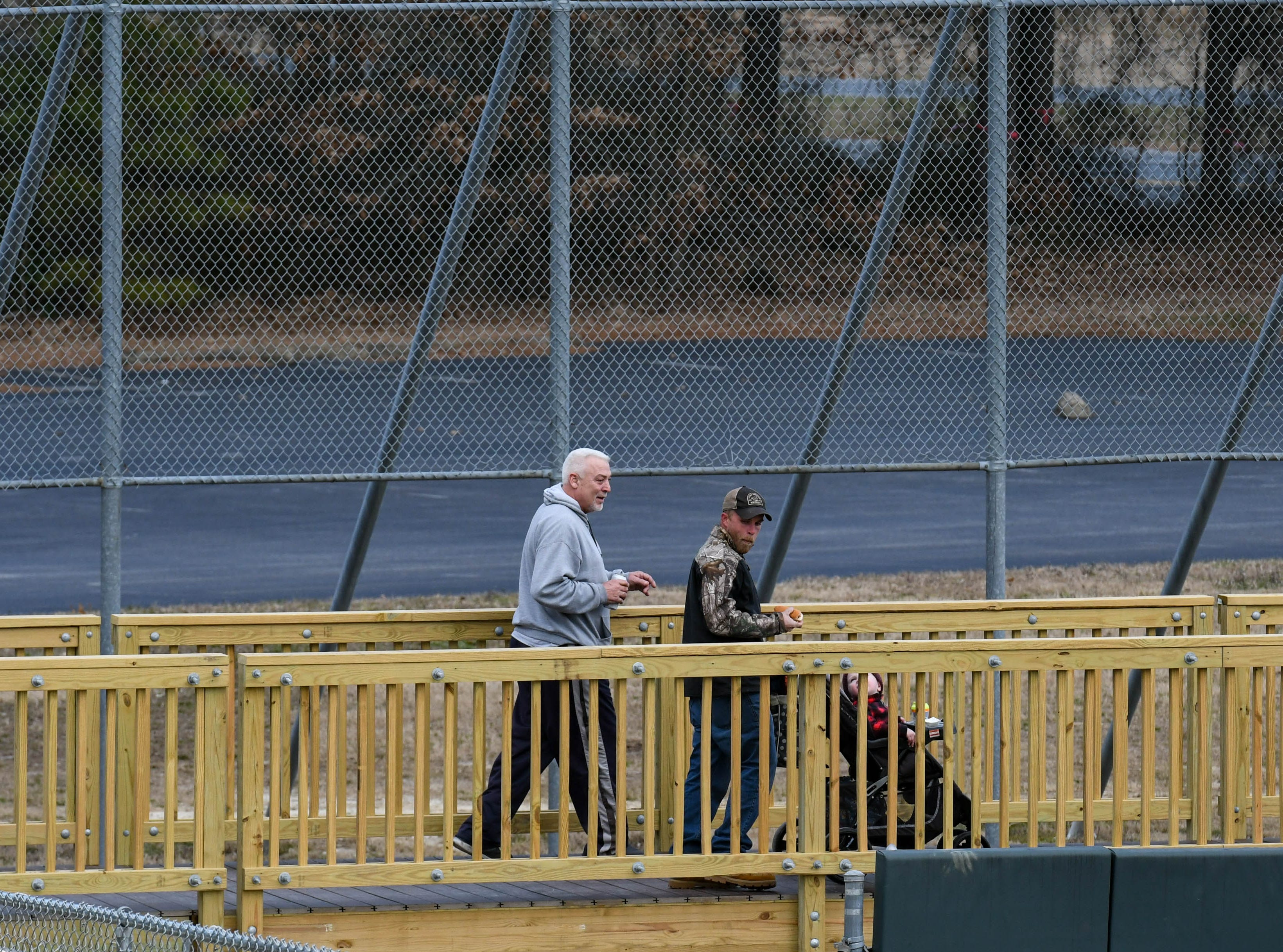 Attendees walk the new wrap around boardwalk deck at Perdue Stadium at an open house event on Wednesday, Mach 13, 2019.