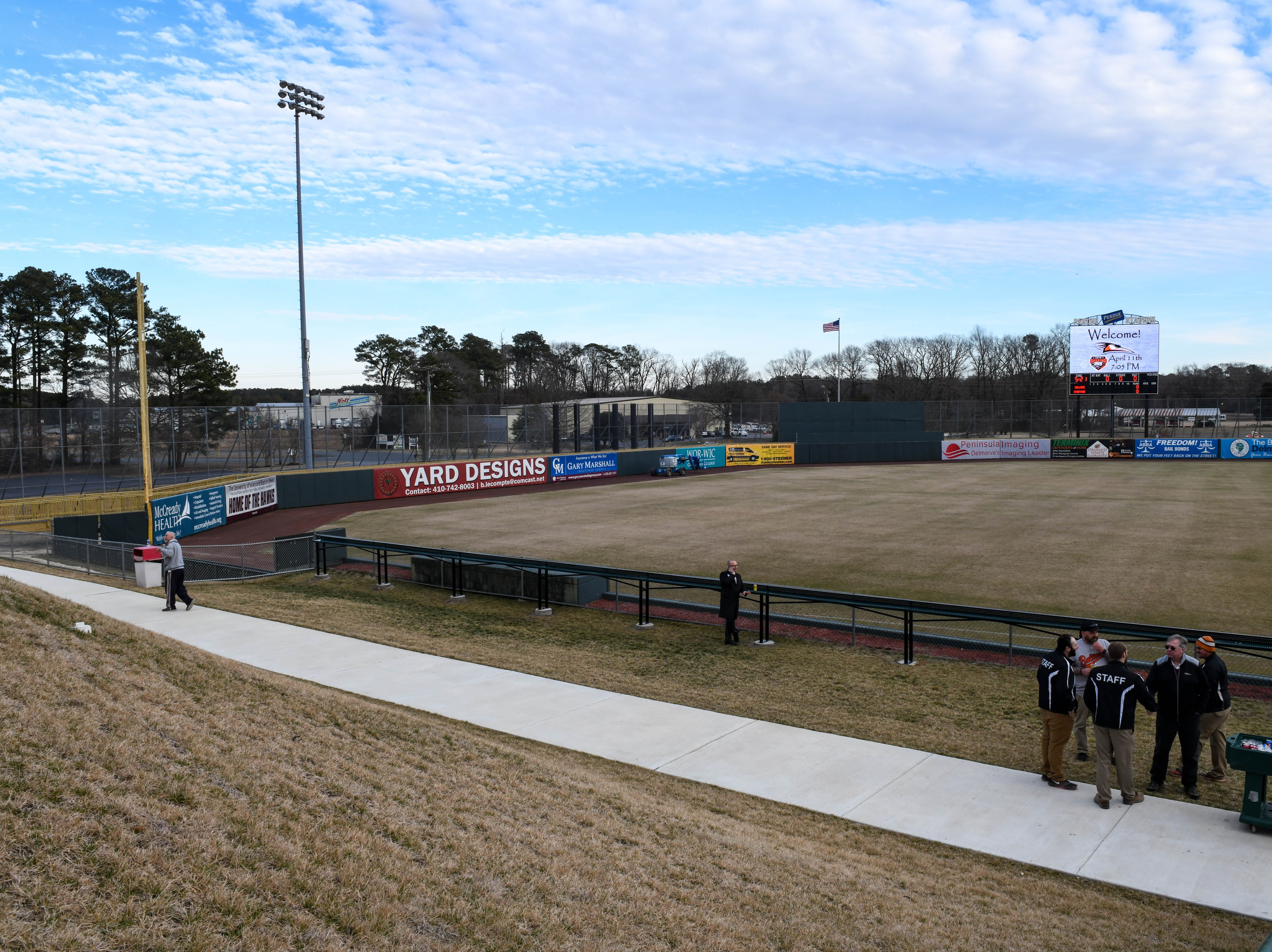 Attendees enjoy the new wrap around boardwalk deck at Perdue Stadium at an open house event on Wednesday, Mach 13, 2019.
