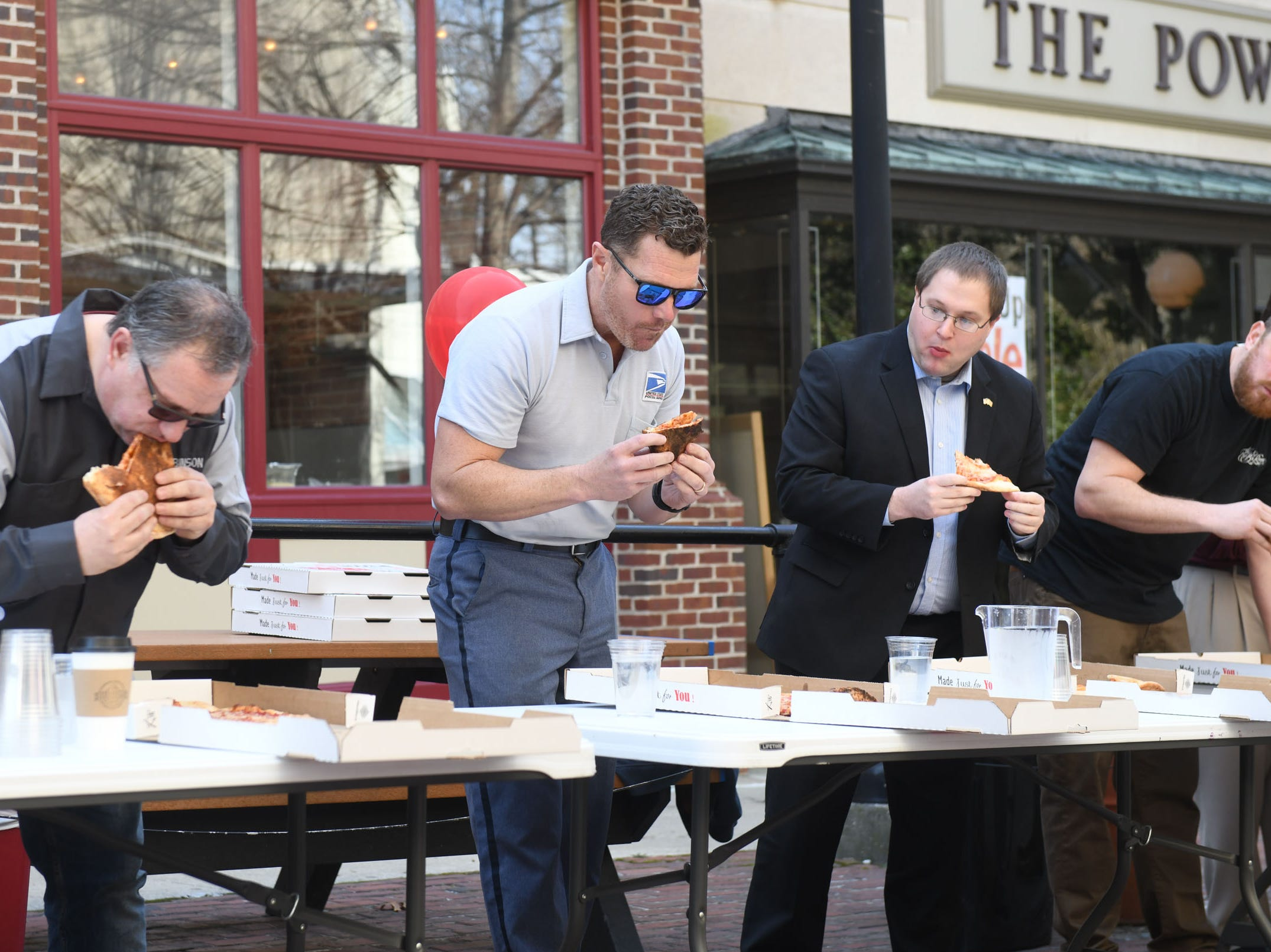 Contestants see who can eat a 16-inch pie during Maya Bella's Pizzeria pizza-pie eating contest during PI(e) Day in Downtown Salisbury on Thursday, March 14, 2019.