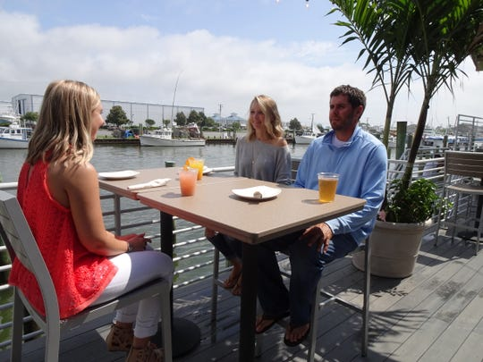 """Ocean City Realtor Chelsea Tull and Annapolis couple Colin and Samantha Long appear on an upcoming episode of HGTV's """"How Close Can I Beach?"""" on Sunday, March 17, 2019. Photo courtesy of HGTV."""
