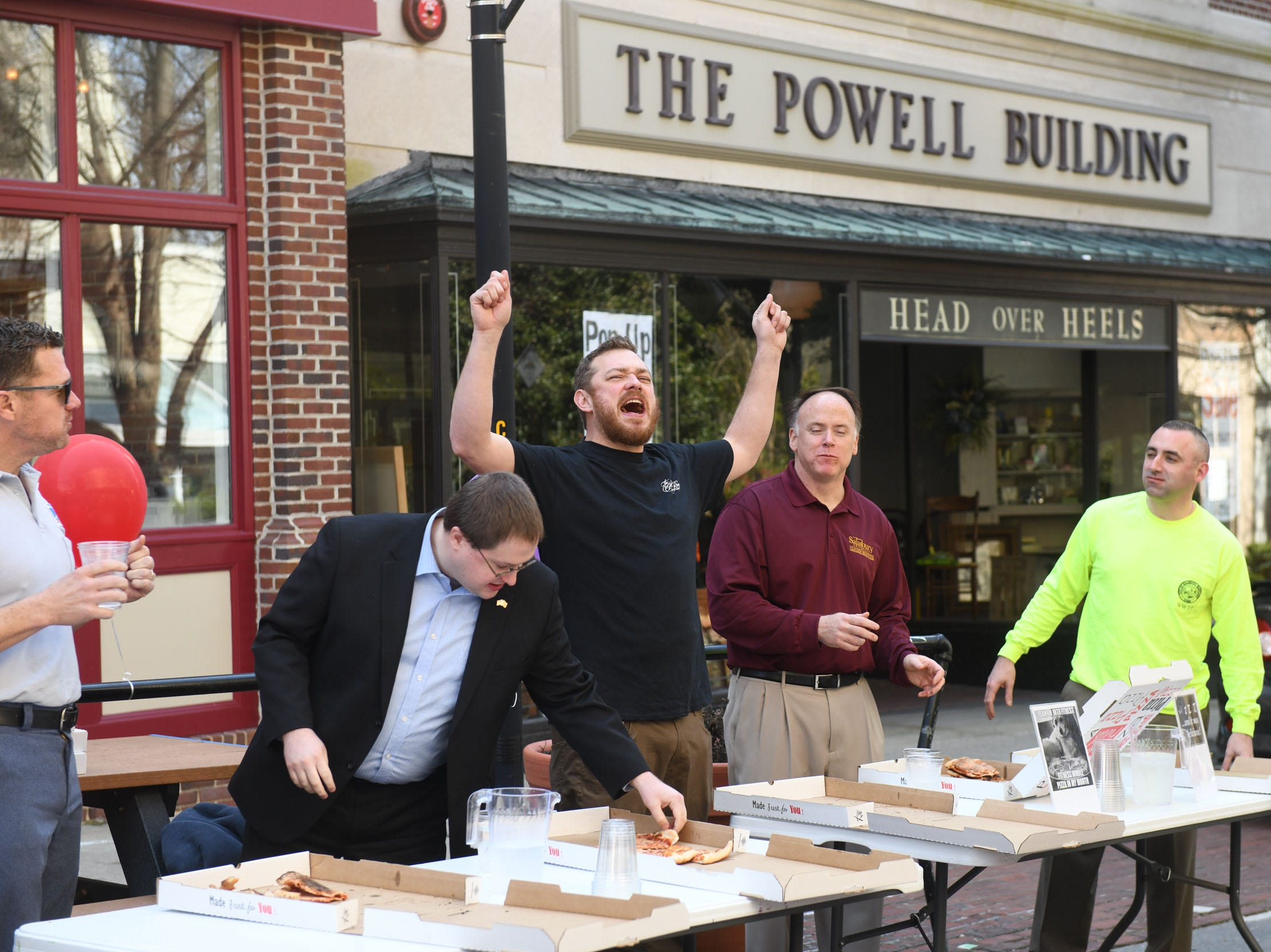 Alex Scott celebrates on eating a 16-inch pie the fastest at 6 mins and 37 seconds. During PI(e) Day in Downtown Salisbury on Thursday, March 14, 2019.