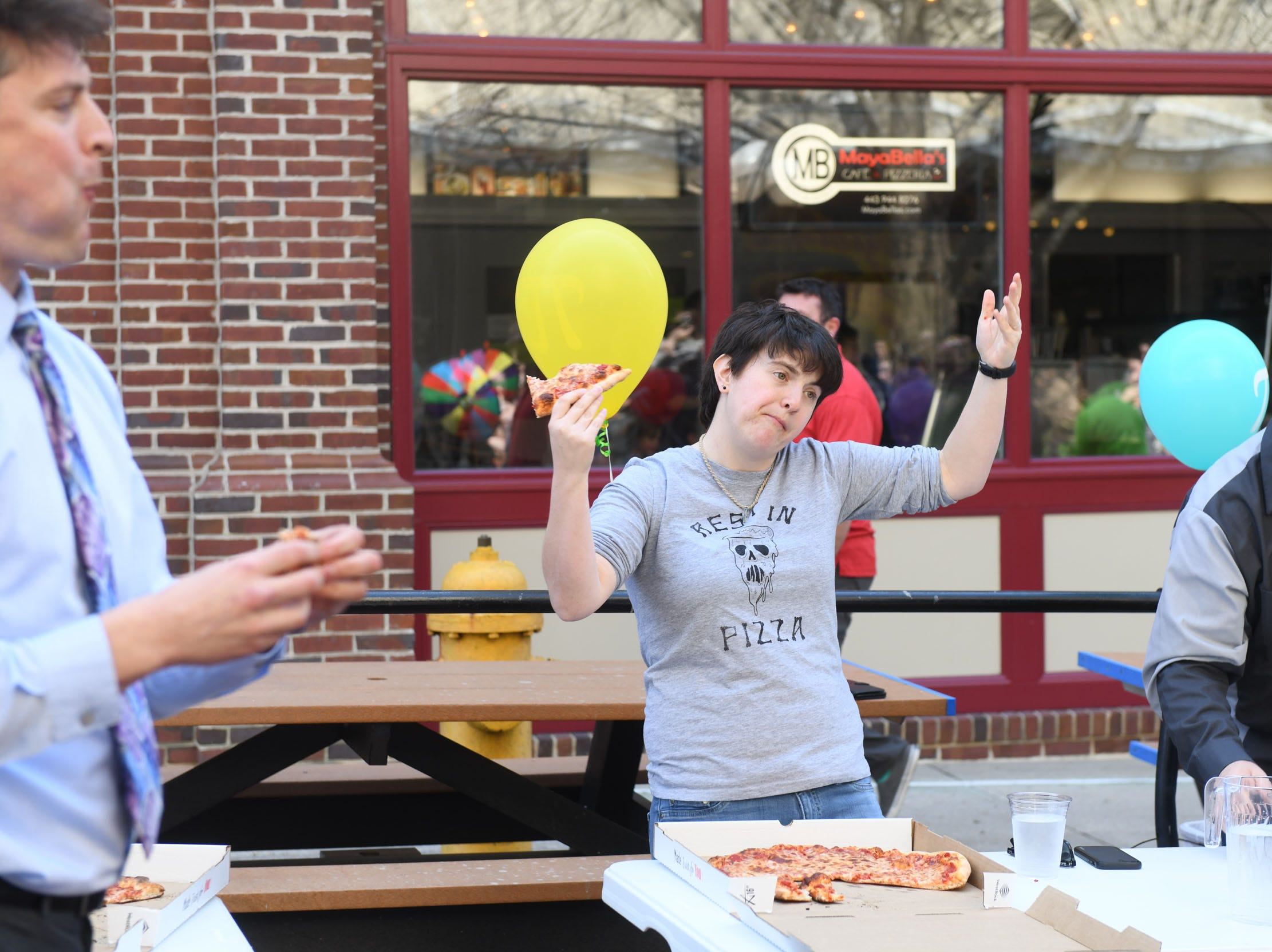 Julie Parson works on eating a 16-inch pie during PI(e) Day in Downtown Salisbury on Thursday, March 14, 2019.