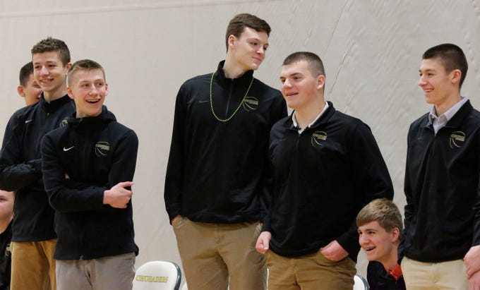 Sheboygan Lutheran players stand while being introduced at the pep rally, Thursday, March 14, 2109, in Sheboygan, Wis.  The team heads its way to state competition.