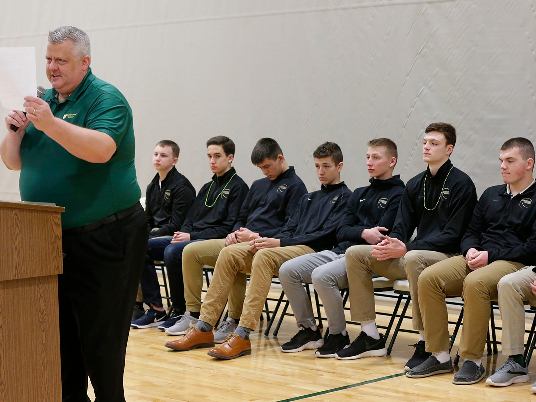 Sheboygan Lutheran's principal Al Holzheimer informs the students of standards of conduct in Madison for the basketball tournament during a rally, Thursday, March 14, 2109, in Sheboygan, Wis.