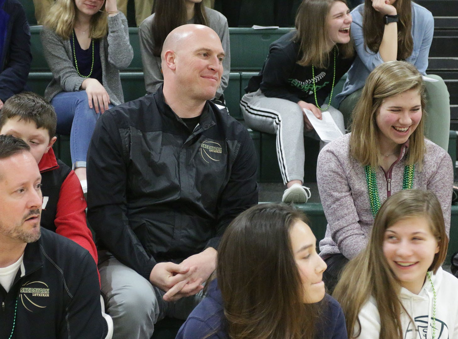 Coach Nick Verhagen smiles during the pep rally for the Sheboygan Lutheran basketball team, Thursday, March 14, 2109, in Sheboygan, Wis. The Crusaders will compete in WIAA Div. 5 basketball competition.