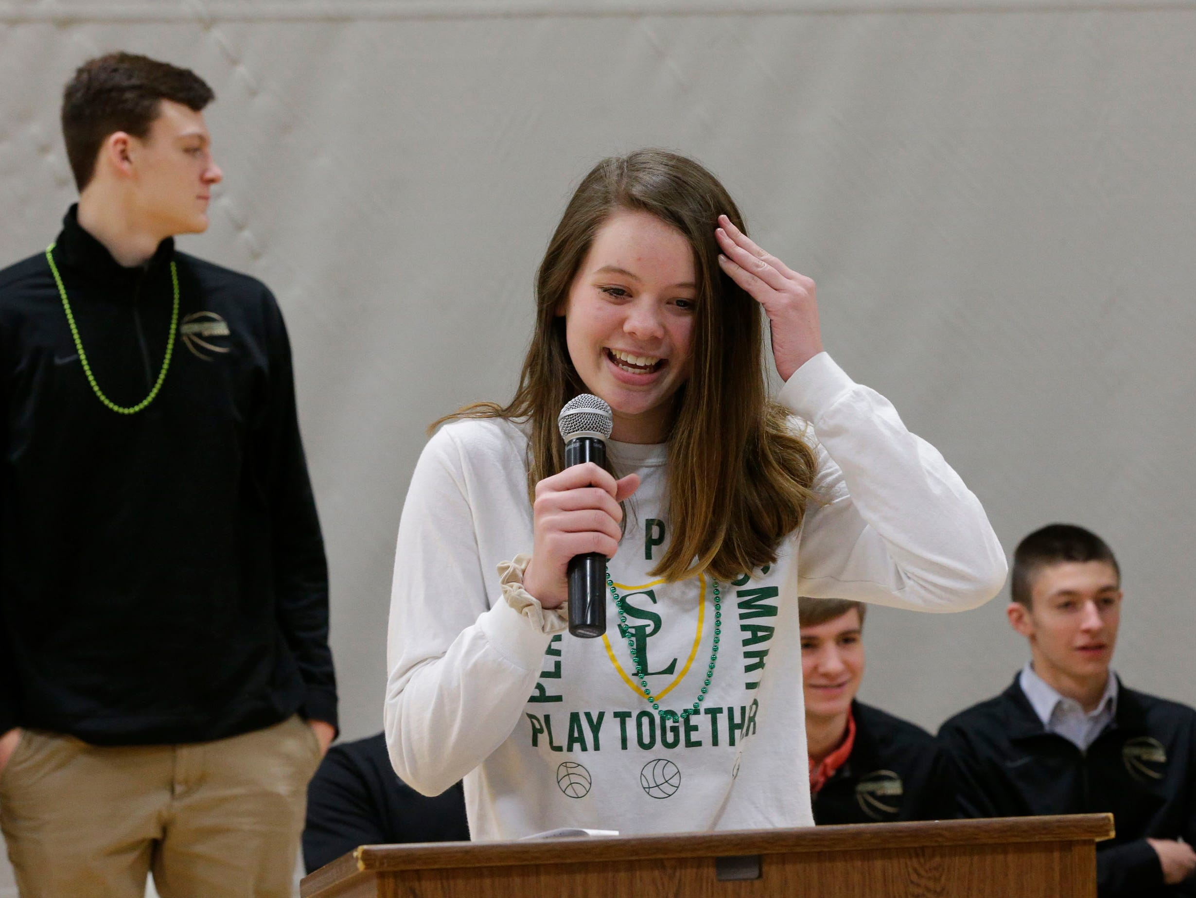 Maddy Pfannkuch reacts to not being able to name all the players on the Sheboygan Lutheran basketball team, Thursday, March 14, 2109, in Sheboygan, Wis. The team travels to Madison for WIAA state basketball competition.