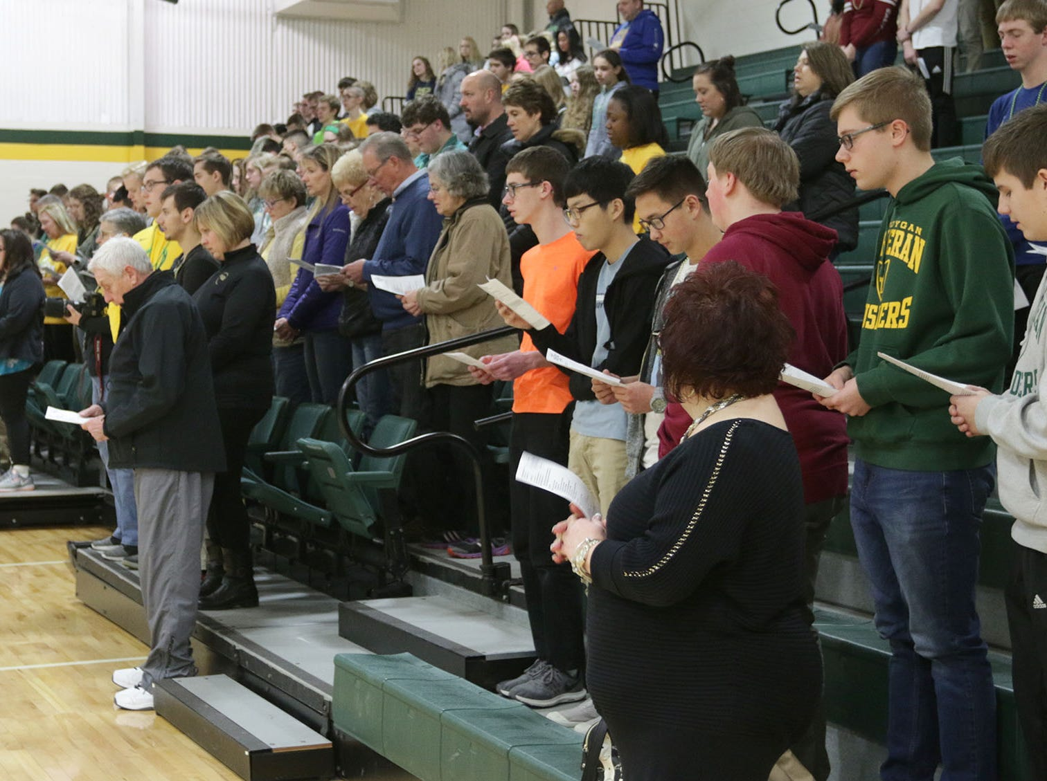 Students and staff stand for prayer before a pep rally, Thursday, March 14, 2109, in Sheboygan, Wis.