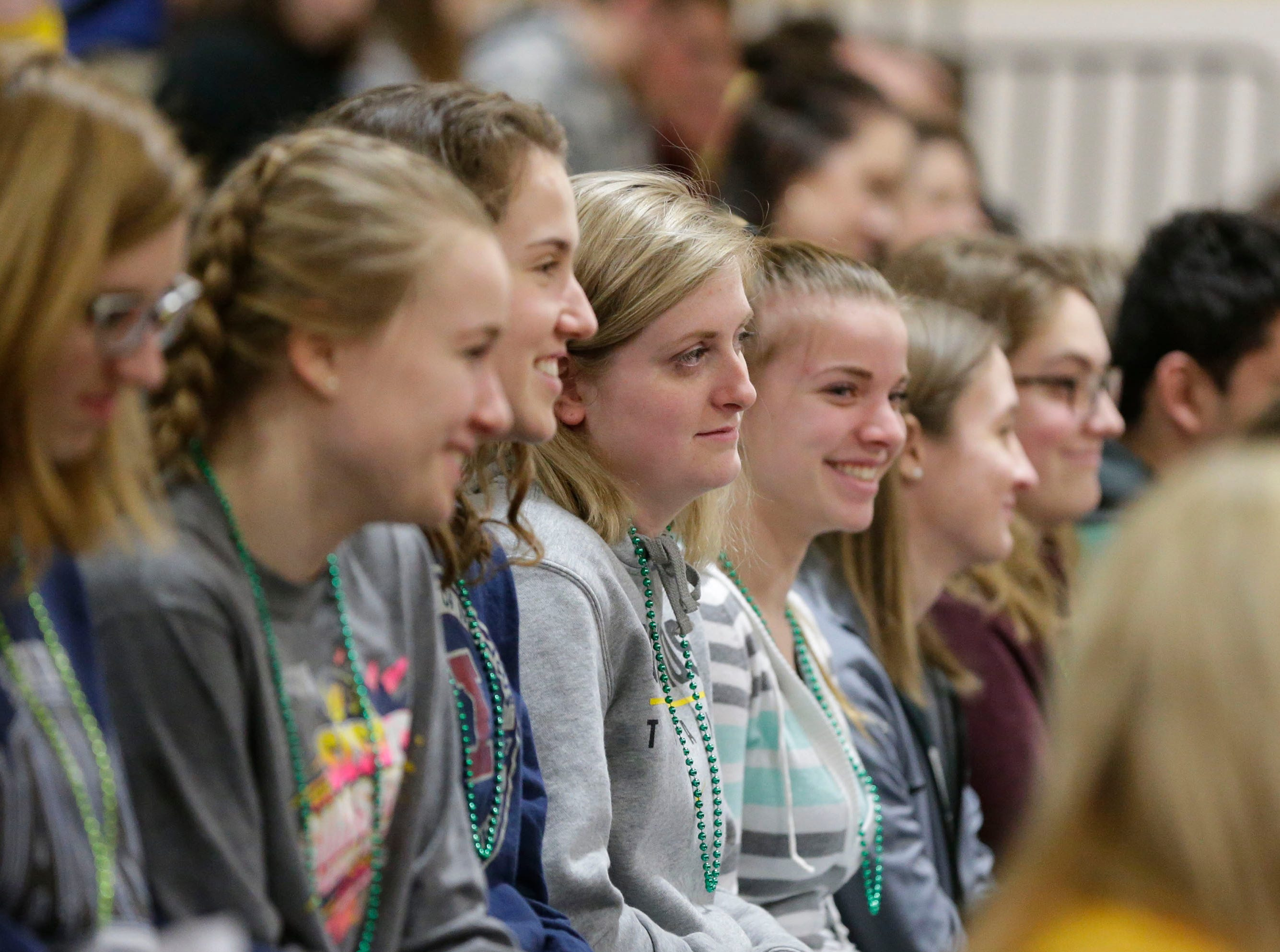 Students listen to speeches about the Sheboygan Lutheran basketball team during a pep rally, Thursday, March 14, 2109, in Sheboygan, Wis. The Crusaders will compete in WIAA Div. 5 basketball competition.