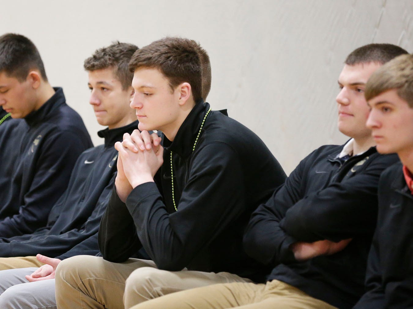 Sheboygan Lutheran basketball players contemplate their trip to state, Thursday, March 14, 2109, in Sheboygan, Wis.