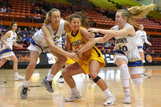 Mitchell's Jordyn Cranny goes against O'Gorman defense in the Class AA quarterfinals Thursday, March 14, in Rapid City.