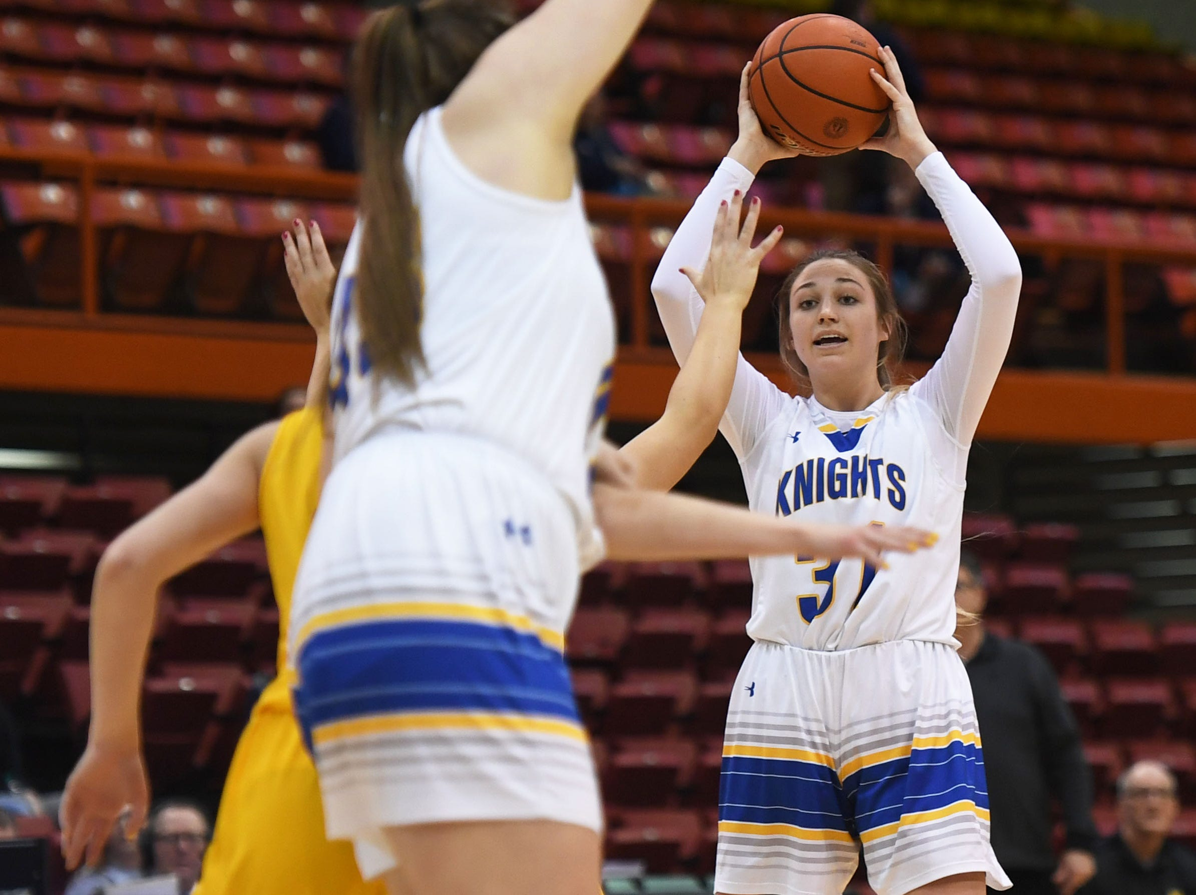 O'Gorman's Emma Ronsiek looks for an open teammate during the game against Mitchell in the Class AA quarterfinals Thursday, March 14, in Rapid City.